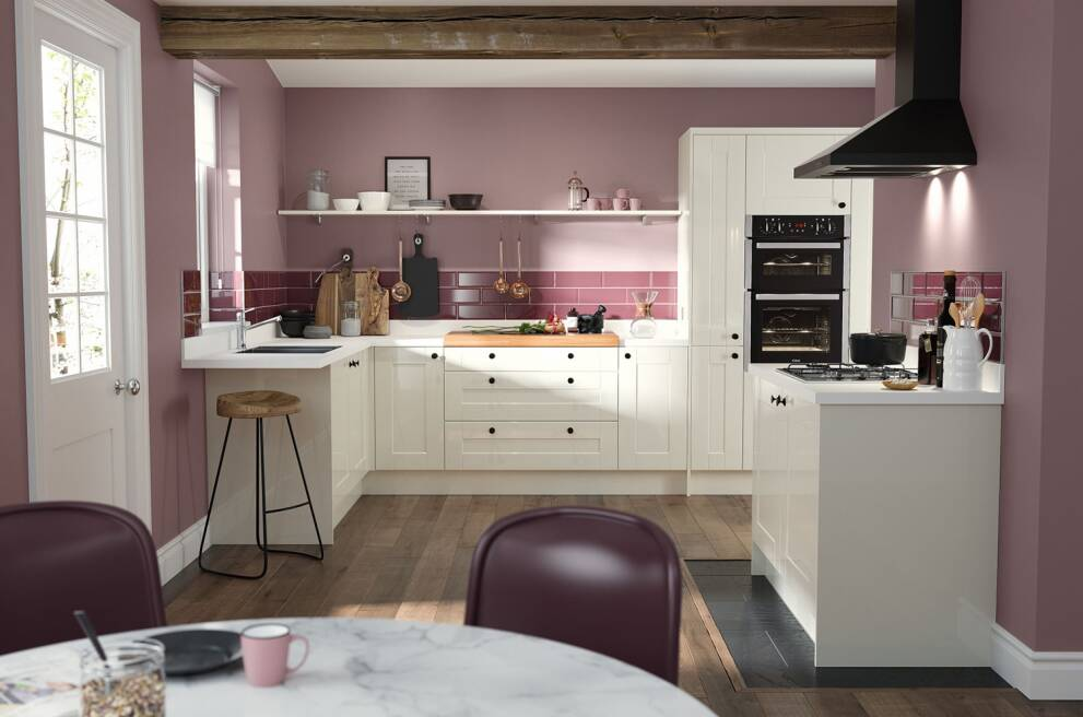 Choose a pink backdrop and keep the cabinets neutral