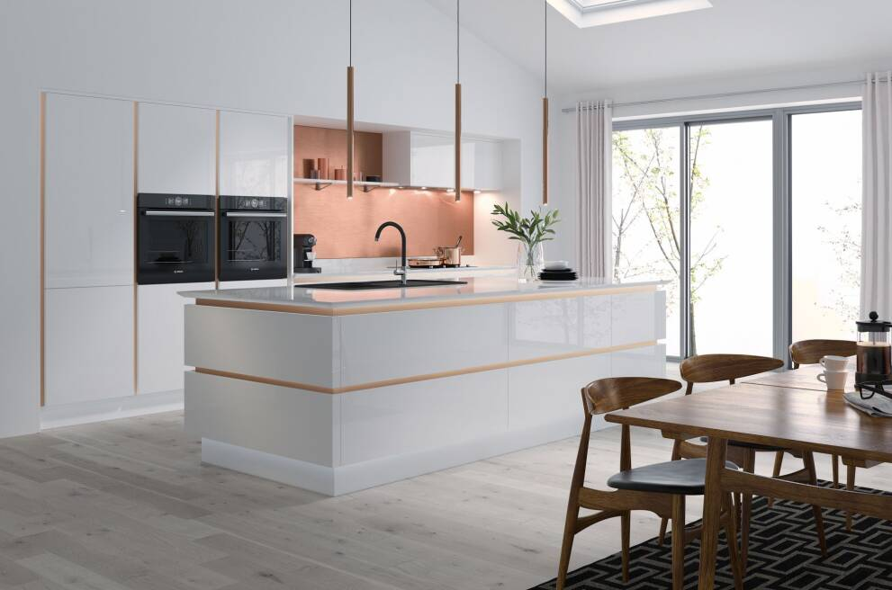 Complement an all-white kitchen with wall colour